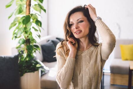 Good looking mid aged woman portrait at home. Elegant Business Woman. Middle-Aged Woman Standing In Modern Home.