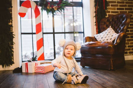 Little boy waiting for Santa Claus at home window on Christmas eve. New Year. Christmas. Children and holidays concept. Banco de Imagens