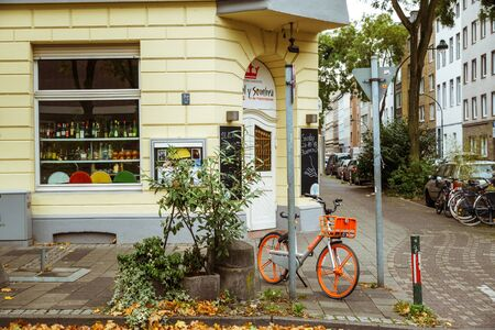 Bicycle Parked On City Street. A city bike in Dusseldorf. Urban bike parked without anyone on European street. Bicycle ecological mode of transport in Europe. Dusseldorf, Germany October 25, 2018.