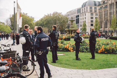 German police officer. Riot Police Germany. Police patrolling in dusseldorf October 27, 2018. German policemen Polizei at work. The subject of law enforcement, public protection, utilities in Europe. Redactioneel