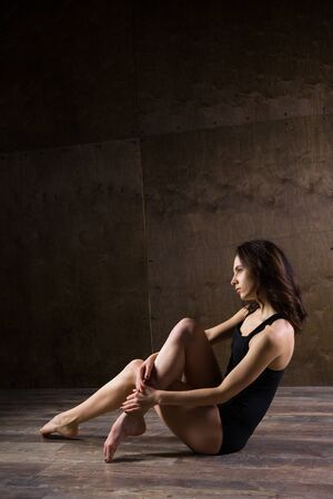 Abstract and stress emotional concept. depressed girl in lonely mood, theme of stressful. Sad woman sitting alone in empty room. Depression and chronic fatigue. female having psychological trauma.