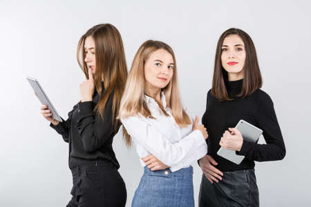 United Team Of Business Women. Portrait team of three smiling businesspeople isolated on white background. business women standing in a row. Female Business Team. Teamwork theme. Business and Finance.
