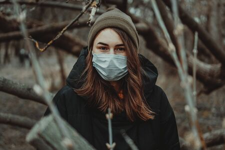 Portrait of young woman wearing medical mask, health protection from influenza virus, epidemic and infectious diseases. Protect your health. Coronavirus concept. Virus spread flu prevention carantine.