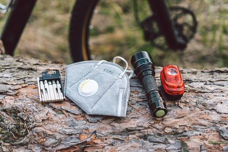 Bike tyre tube puncture repair tool kit. Items replacements and tools for a safe cycling. face mask, with filter pm 2.5. Flu epidemic, dust allergy, protection against virus. Covid 19 virus concept.