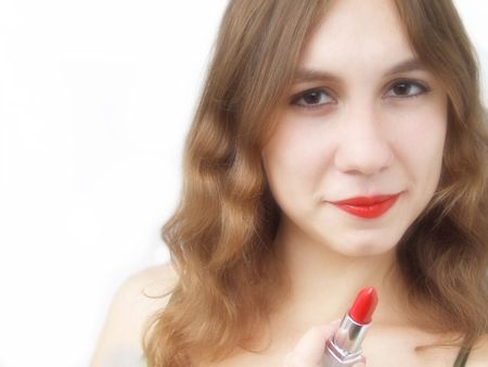 Beautiful girl holding bright red lipstick photo