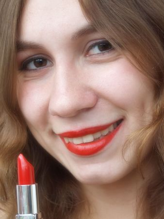 Smiling beautiful girl with lipstick photo