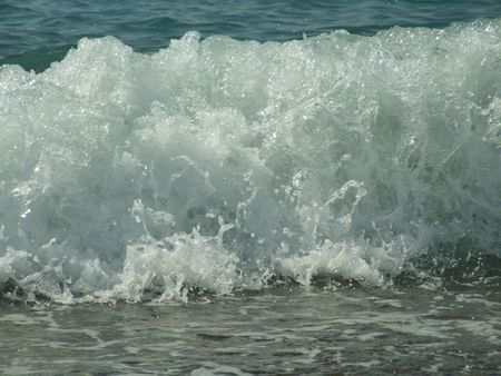 foamy: foamy wave hitting the beach, close up Stock Photo