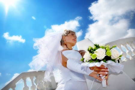 a young beautiful bride against bright blue sky Stock Photo - 3239407
