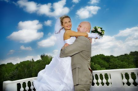 bride and groom embracing against beautiful cloudy sky Stock Photo - 3239414