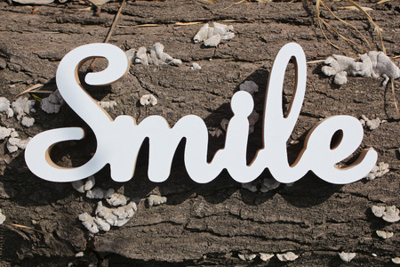 positive smile text on wood background