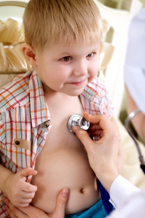 examination of a sick child at home pediatrician Stock Photo - 14228709