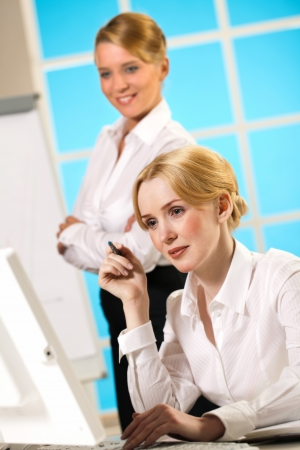 belonging to the caucasoid race: Two girls on favorite in the office Stock Photo