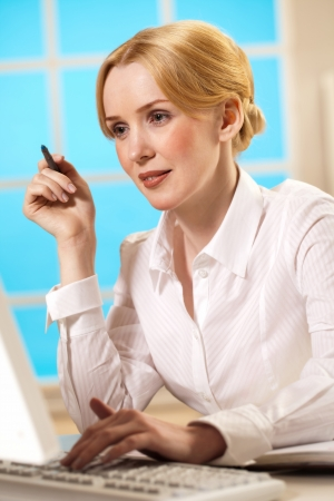 belonging to the caucasoid race: a young woman working in office