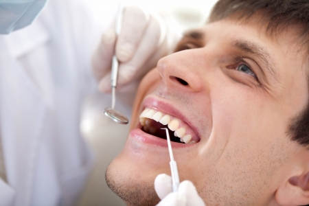 A man visiting a dentist photo