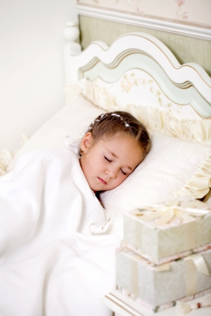 little girl resting in the bedroom photo