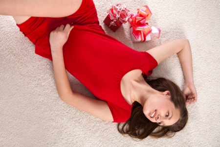 girl in a red dress is a gift photo