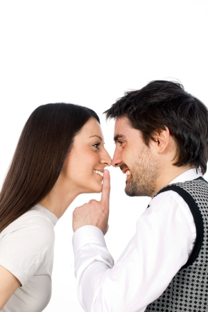 confidentially: couple flirting on a white background