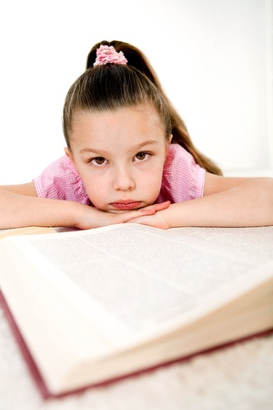 schoolkid search: girl with book on white background Stock Photo