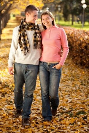 fun couple walking in autumn photo