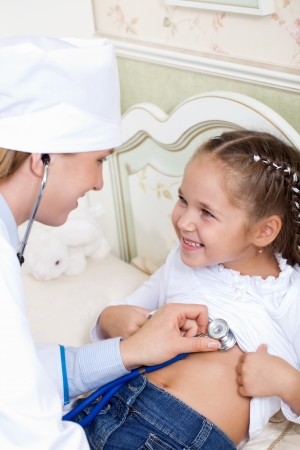 belonging to the caucasoid race: girl doctor listens to breathing