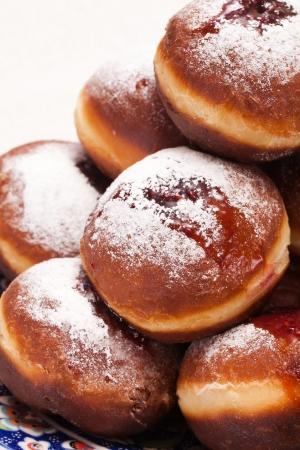 Jewish holiday baking donuts with syrup photo