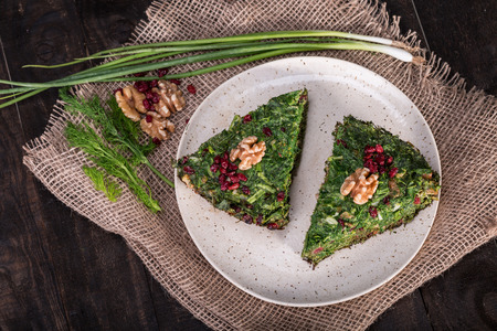 Top View of Persian Mixed herbs frittata with barberry and walnut Kuku and Zereshk Stock Photo
