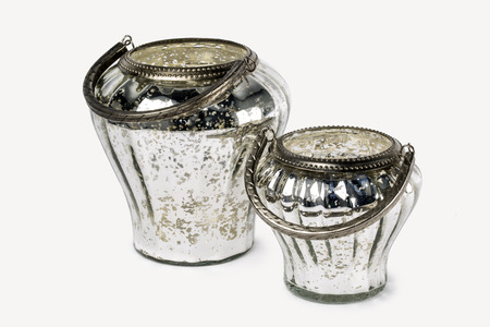 TWO DECORATIVE ROUND SILVER GLASS BUCKETS CANDLE HOLDER Stock Photo
