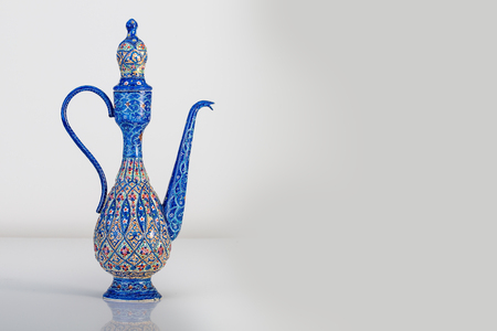 Persian Rosewater Bottle Container With Enameling  (Minakari) Design handcrafted With Azure Blue Colors And Ornaments Patterns On The Surface Of Metal Isolated On White Background