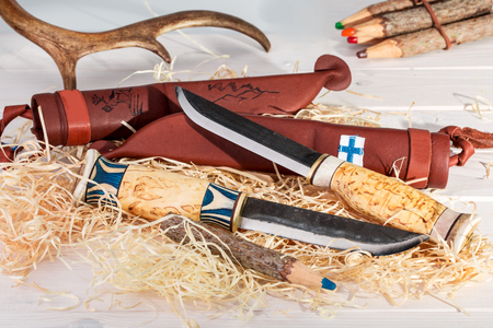 Traditional Finnish Belt Knives (Puukko) With Curving Cutting Edge And Leather Sheath Hand Crafted From Wood, Reindeer Horn And Steel, Finland's 100 Years Celebration Stock Photo