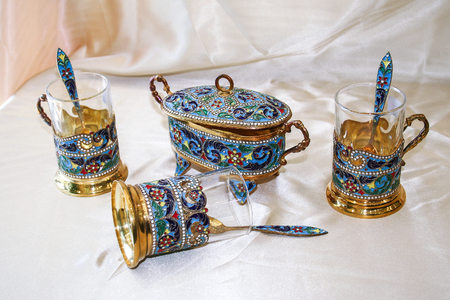 Antique handmade Persian Enamel Gold Tea Set consisting of a Sugar cube holder long Tea spoons and Cups with handle  from city of Isfahan, Russian Cloisonne
