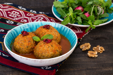 Koofteh Tabrizi Large Meatballs Stuffed With Dried Fruits And Nuts In Tomato Turmeric Broth A Traditional Azeri And Iranian Dish Served In Turquoise Bowl Garnished With Barberries 스톡 콘텐츠