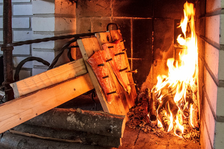 Traditional Finnish fish dish, Smoked salmon or trout on a wooden plank prepared in a special way in fireplace - Loimulohi