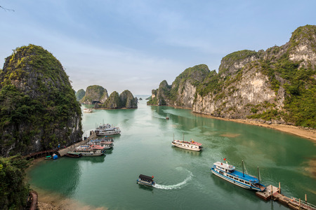 spectacular Panoramic view of Ha Long Bay, in northeast Vietnam with emerald green waters and towering limestone junk boats and sea kayak