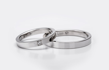 Matching Wedding and Engagement white gold Rings on white background