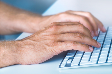 Close up Hands typing on Keyboard