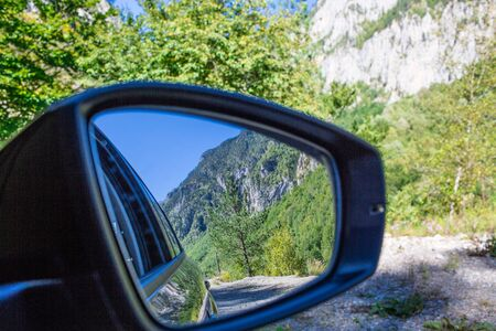 Close Up Of A Side Mirror Of The Car Reflecting The Beautiful Green Scenery Of The Forest By The Road