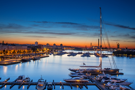 Panoramic View Of The Beautiful Blue And Orange Sky Of Helsinki Harbor With Boats And Yachts At A Summer Night. Capital Of Finland Europe's Travel Sightseeing