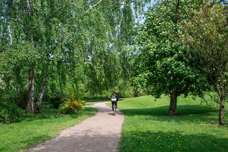 Beautiful Green Walking Path in the City Park During Summer in Helsinki Finland