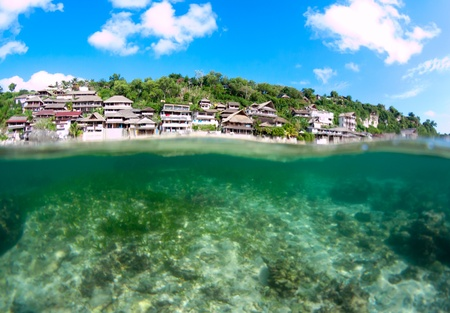 Hald underwater shot of Bingin bay beach in Bali