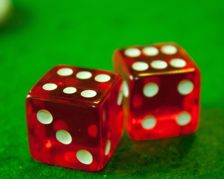 Two red and white dices double six with green background