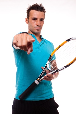 A young tennis man inviting with his finger pointing photo
