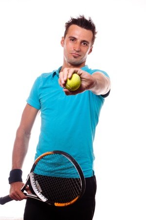 A young tennis man holding a racket and showing a ball in his hand