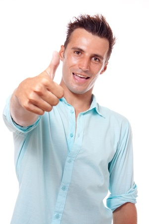 A young man wearing a blue shirt happy showing his thumbs up photo