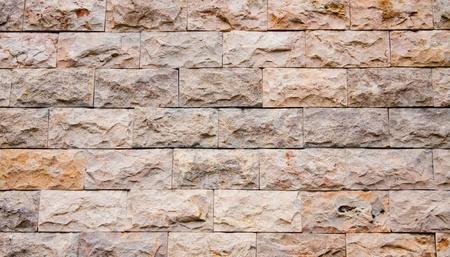 A brickwall made of granite stone
