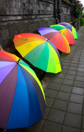 multi colors: A set of open umbrella waiting on the ground at besakih temple