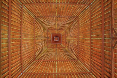 A wooden roof construction from the inside photo