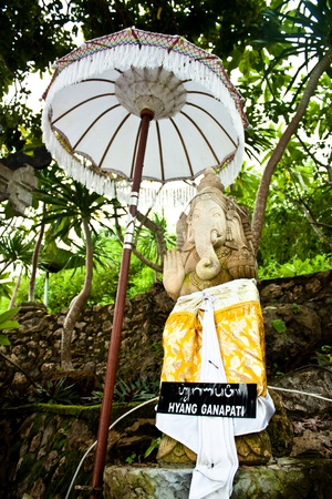 Statue of ganesh with an umbrella Stock Photo