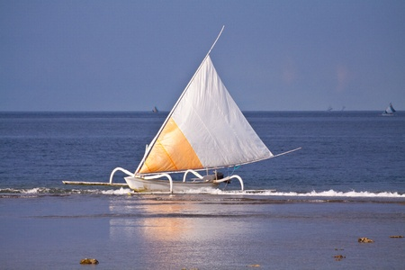 Sailboat in Bali with reflections