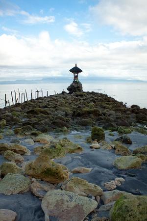 A small hindu temple near the ocean
