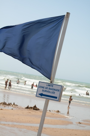 A blue flag for the safety zone on the beach